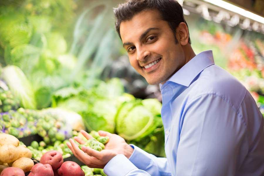 Choosing vegetables in grocery store